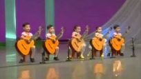 Five North Korean Children Playing Guitars