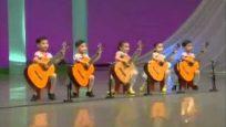 Five North Korean Children Playing Guitars