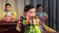 Flutist and children's band at Sinuiju Kindergarten, North Korea