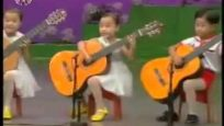 North Korea children playing the guitar  Creepy as hell