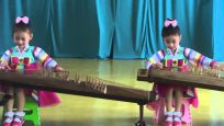 North Korea: Kindergarten Kids Playing Gayageum in Chongjin